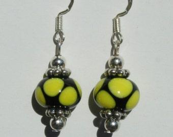 Black and yellow lampwork bead earrings