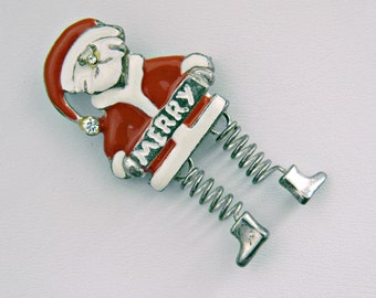 Vintage Santa Christmas pin. Santa springs into action! Boots dangle at the end of two springs for legs. Fun piece.  SC-35
