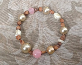Pearl and ghost bead stretchy pastel and earthtone bracelet