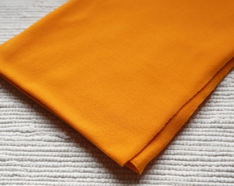 Fleece/pile fabric. 50x50 cm. Orange colour