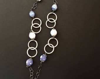 Chanel necklace with blue and white striped agate with gunmetal and silver chain.