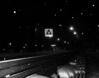Urban Night Winter Scene: Boston University; Boston, MA; Citgo Sign; park bench