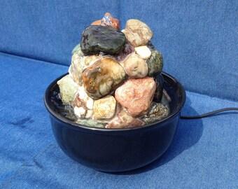 Desktop fountain made of pebbles I collected on a central California beach.