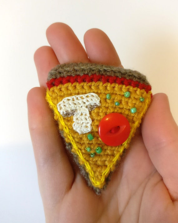 Crochet pizza slice brooch with surface embroidery, beads & a button
