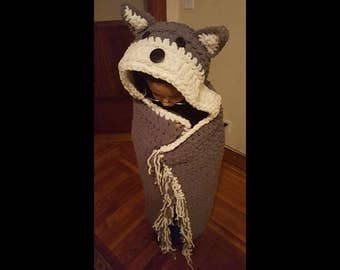 VERY thick, soft, and warm child size hooded wolf blanket; folds up into throw pillow for storage/display