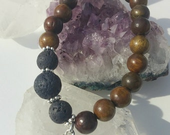 Aromatherapy Root Chakra Lotus Bracelet with sample of essential oil
