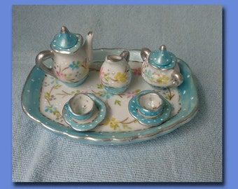Miniature of teapot and teacups