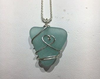 sea glass necklace. Hand crafted with sterling silver wire and a 18' diamond cut chain