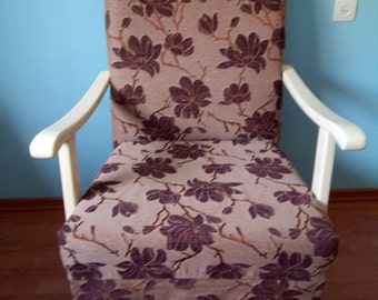 A large armchair with wooden handles. Vintage. After restoration.