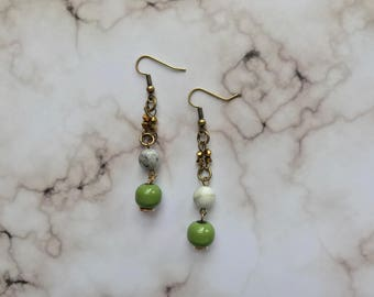 White and green beaded drop earrings