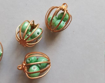 Vintage copper cage charms with green beads