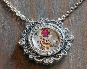 Steampunk Jewelry - Pendant - Watch movement and ruby red crystal
