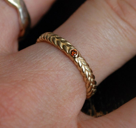 3mm width gold braid ring with red cognac diamond