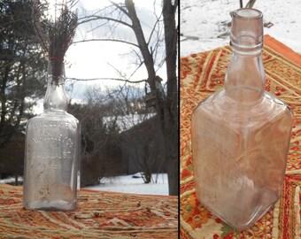 Antique late 1800s early 1900s H W Huguley Co 134 Canal Street Boston Full Quart large embossed glass whiskey bottle barware decor boho vase