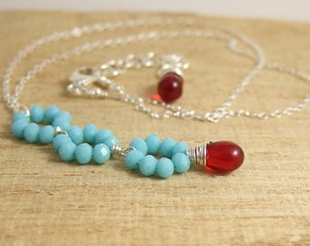 Necklace with Tiny, Turquoise Blue Crystal Rondelles and a Red Glass Teardrop Wire Wrapped with Sterling Silver Wire CDN-697