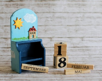 Wooden perpetual calendar with home, sun and handpainted clouds - Day cubes and months in a caddy box