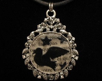 ephemera necklace - punched paper crow/raven and black stars on French book page text