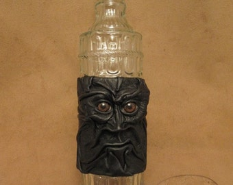 Grichels leather and glass fancy bottle - black leather with brown bear eyes