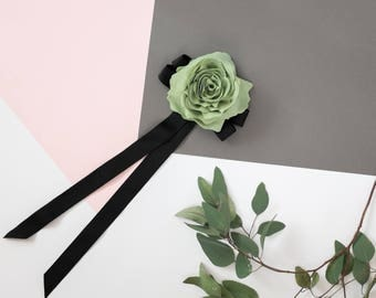 Light green flower brooch with a black bow made from ribbon, bow tie brooch with flower
