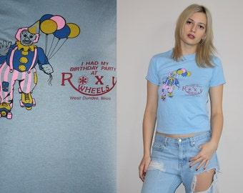 Vintage 1980s Screen Stars 50/50 Cotton Poly Pastel Blue Scary Clown on Roller-skates with Balloons Baby T Shirt  -  80s VTG Tees  -  W00558