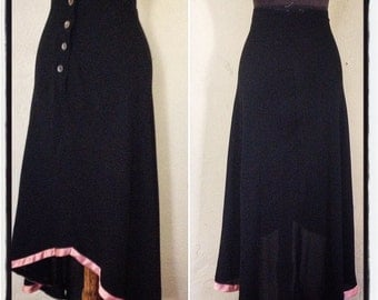 Vintage 1970's Midi Length, high waist,  bias cut, asymmetrical  crepe skirt, with train back and satin trim. Size US 4 / UK10