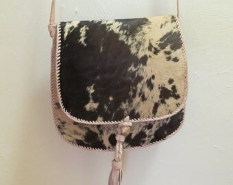 Cowhide Fur Handbag Shoulder bag adjustable strap / Never used / 9x9x3 plus strap