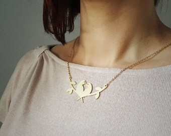 Gold or Silver Love Birds on a branch