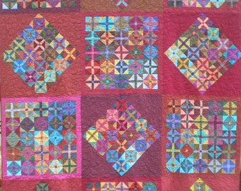 Colorful Contemporary Predominately Red Full Size Quilt in Solid Fabrics