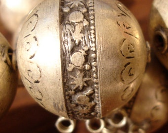 Moroccan  tarnished large bead with star sun and moon and three loops