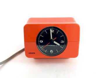 Vintage seventies Krups Comfortime 3 Type 672 electric alarm clock in orange plastic, made in Germany
