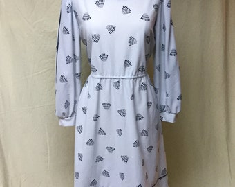 Vintage grey long sleeve secretary dress. Size large. Art Deco fan shapes on sheer fabric.
