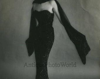 Gorgeous woman model in gown vintage art photo