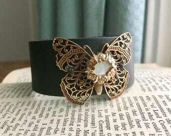 Women's Wide Black Leather Cuff with Antiqued Brass Filigree Butterfly and Freshwater Pearl Coin