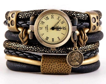 bracelet and a watch, cuff, stylish watch, gold and black