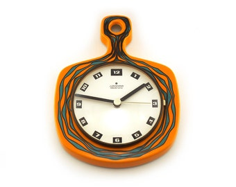 Retro orange earthenware / ceramic glazed wall clock. By Junghans, Germany