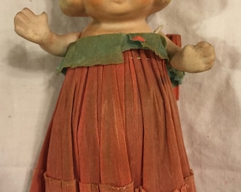 Antique Betty Boop or Kewpie type bisque doll/ original crepe paper dress