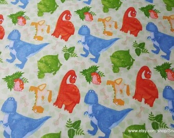 Flannel Fabric - Dinosaurs and Tracks on Green - 1 yard - 100% Cotton Flannel
