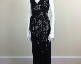 black sequined formal dress w/ deep V neckline & high slit 60s