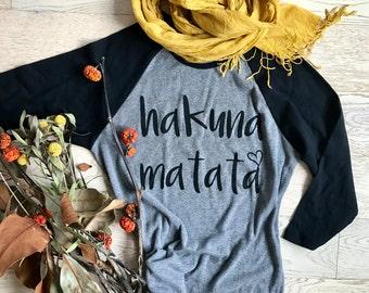 Hakuna Matata. Disney Shirt. Clothing. Women's T Shirts. T Shirts. Ladies Fit. Womens's Raglan Shirts. Baseball Raglan Shirts