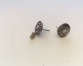 Sterling silver small button post earrings.