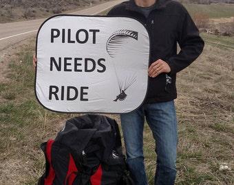 "Paragliding ""Pilot Needs Ride"" Sign"