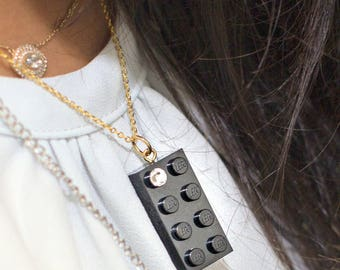Black LEGO (R) brick 2x4 with a Diamond color SWAROVSKI crystal on a Silver/Gold plated trace chain or on a Black ballchain