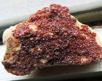 Crystals of vanadinite on ideal matrix as a gift for a collection of minerals.