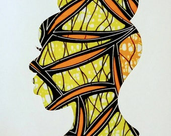 Female silhouette in yellow and orange African print fabric, cut paper art