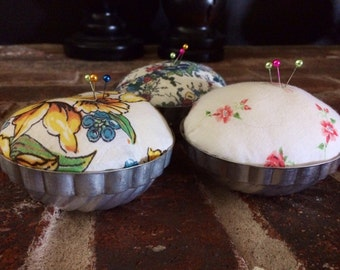 Vintage Tin Mold Pincushion w Vintage Handkerchief fabric.