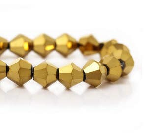 48 beads top Bicone 6mm faceted Golden glass