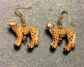 Orange spotted ceramic cheetah bead earrings adorned with orange Czech glass beads.