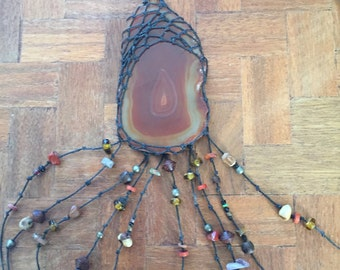 Hanging agate slice with wax linen thread and assorted beads, nature inspired home decor
