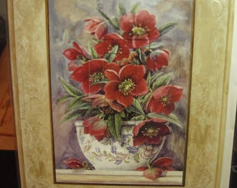 A Handmade Card with Red Flowers in a Vase
