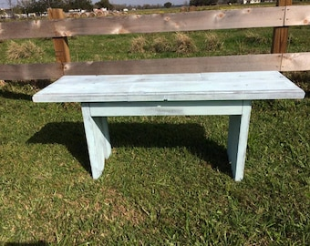 Distressed blue on gray bench